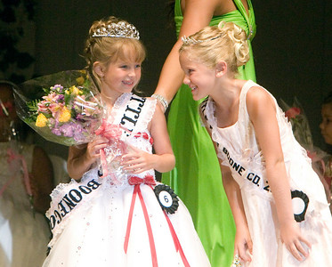 The 2008 Little Miss Boone County, Breyon Johnsons, 8 (left), gets congratulated by last year's winner, Amanda Appelhans, during the Miss Boone County Fair competition on Tuesday night.