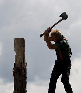 Lumberjack Derek Knutsen of Hayward, Wis. chops a log in the Scheer's Lumberjack Show at the Boone County Fair on Saturday, August 9.