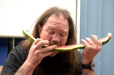 Bruce Boettcher of Caledonia finishes his slice of watermelon during the watermelon eating contest at the Boone County Fair on Wednesday, August 6.  Boettcher won 2nd place in the competition, while his wife Karen won third place.