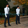 A pair Air Force ROTC Cadet with an Army ROTC cadet photographer behind them.
