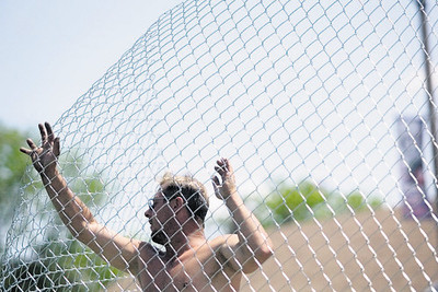 Record-Eagle/Jan-Michael Stump<br /> Mike Peterson of Perfect Fence helps erect perimeter fencing around the Open Space Tuesday for the upcoming National Cherry Festival.