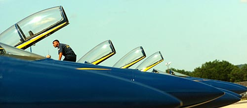 Record-Eagle/Tyler Sipe<br /> Blue Angels crew chief Michael Finch inspects plane number four.
