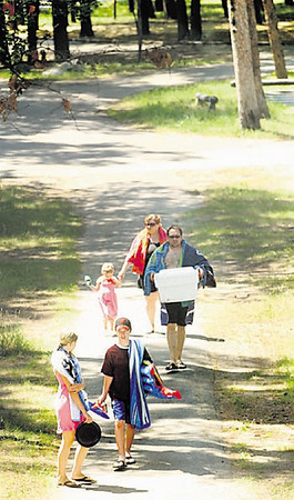 Clockwise from bottom center, Terry Myers, 13, sisters Gabriella Glenboski, 13, Madalyn Glenboski, 4, and parents Bethany and Jim Glenboski depart the Traverse City State Park campsite to the beach Thursday.