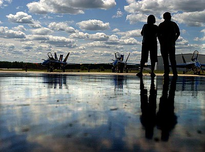 Record-Eagle/Tyler Sipe<br /> Traverse City residents Mark and Connie Drake are silhouetted watching the Blue Angels during a Friday afternoon event for friends, family, spectators and media at the Coast Guard Air Station Traverse City. Mark and Connie's daughter Lisa Drake has been working with the Blue Angels for three years as an aviation electrician.