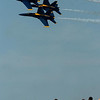 Record-Eagle/Tyler Sipe<br /> Four Blue Angels Boeing F/A-18 Hornet planes speed by spectators during Saturday afternoon's National Cherry Festival Air Show over Grand Traverse Bay in Traverse City. The planes can travel as close as 18-inches apart from wing tip-to-wing tip.