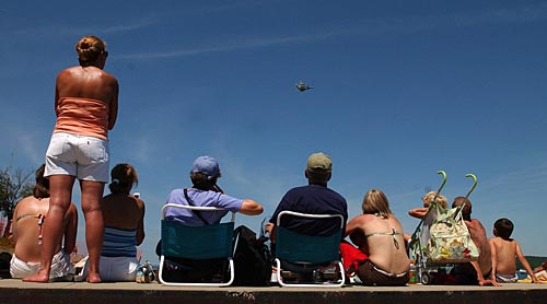 Record-Eagle/Tyler Sipe<br /> Crowds enjoy Saturday afternoon's National Cherry Festival Air Show from a boat launch at the Clinch Park Marina on Grand Traverse Bay in Traverse City.