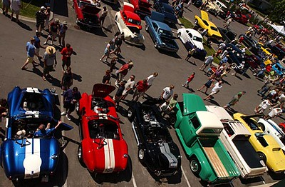 Record-Eagle/Tyler Sipe<br /> Hundreds of people come to observe over 250 cars on Sunday morning during the National Cherry Festival Hagerty Family Car Show in Traverse City.