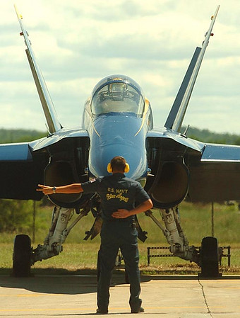 Record-Eagle/Tyler Sipe<br /> Blue Angels aviation electrician petty officer Brian Cioffi of Albany, New York, signals to Major Nathan Miller to start engine two of his Boeing F/A-18 Hornet.