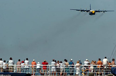 Record-Eagle/Tyler Sipe<br /> The Blue Angels aircraft coined Fat Albert Airlines, a Lockheed-Martin C-130T Hercules, flies toward spectators during Saturday afternoon's National Cherry Festival Air Show over Grand Traverse Bay.