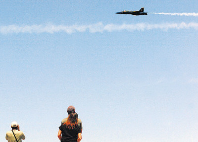 Record-Eagle/Tyler Sipe<br /> Spectators, including from left, Butch McCrimmon of Lake Ann, and Ken Ramos of Bridgeport, Conn., watch the Blue Angels practice on Thursday at the Open Space.