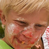 Record-Eagle/Douglas Tesner<br /> Sam Schmitt, 6, a festival prince from Traverse City East Elementary School, dives into the Sara Lee Bakery Kids Cherry Pie Eating Contest face first.