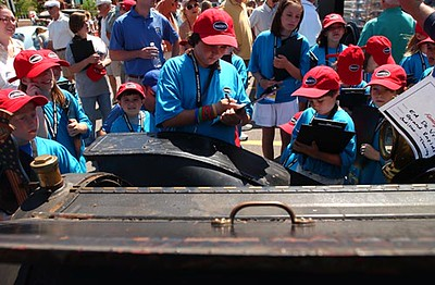 Record-Eagle/Tyler Sipe<br /> Dozens of youth coined Hagerty Young Judges observe and rate a few of over 250 cars on Sunday morning during the National Cherry Festival Hagerty Family Car Show in Traverse City.