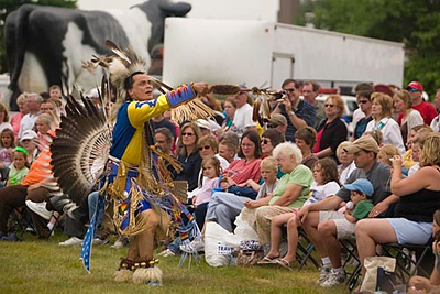 Record-Eagle/Jan-Michael Stump<br /> Ken Quitugua dances with The Grand Traverse Band of Ottawa and Chippewa Indians during their Native American Pow Wow Dance at the Open Space Tuesday for the National Cherry Festival's Heritage Day.