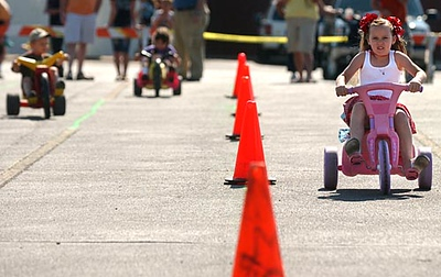 Record-Eagle/Tyler Sipe<br /> Five-year-old Brittany Moreno of Traverse City competes with an intimidating game face during Saturday morning's National Cherry Festival Big Wheel Race at the Preferred Outlet Center in Traverse City.