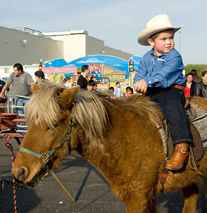 """Hector Morales, Jr., 3, of Belvidere enjoys a ride on a pony at the Cinco de Mayo celebration in Belvidere last Sunday.  """"He always dresses like this during carnival times.  He loves horses,"""" said his mother."""
