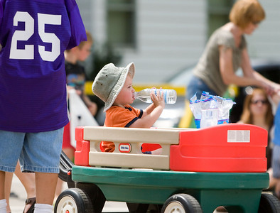 Ben Mitchell, 2, of Hampshire enjoys a refreshing drink of water during Coon Creek Country Days in Hampshire on Sunday, August 3.