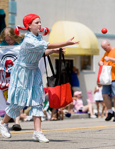 Wendy from Wendy's Restaurant threw plastic balls to attendees of the parade during Coon Creek Country Days in Hampshire on Sunday, August 3.