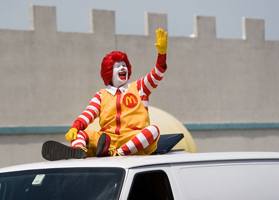 Ronald McDonald waves to the crowd during the Coon Creek Country Days parade in Hampshire on Sunday, August 3.