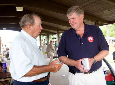 Republican Congressional candidate Jim Oberweis (right) chats with Henry Warfel of St. Charles during the Coon Creek Country Days in Hampshire on Sunday, August 4.