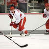 Record-Eagle/Jan-Michael Stump<br /> Red Wings center Justin Abdelkader (center) and right wing Darren McCarty (right) skate together at training camp Saturday at Centre ICE Arena.