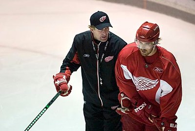 Record-Eagle/Jan-Michael Stump<br /> Red Wings coach Mike Babcock talks with center Henrik Zetterberg during training camp Saturday at Centre ICE Arena.