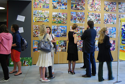 Parents examine their childrens' artworks