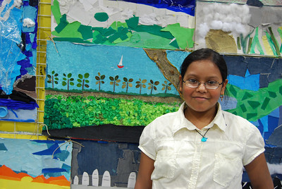 Sohini with her collage in the background