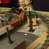 Griffon, 4, and Sara Maleski, of Leland, keep an eye on the workings of a passing 0-scale train.