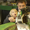Landon Leiby, 1 ½, watches in wide-mouth wonder as he and his father, Charlie Leiby of Suttons Bay, take in all the model trains.