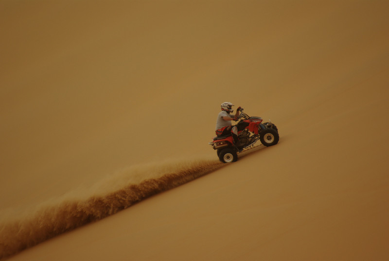 Ray having a go racing up a massive sand dune!