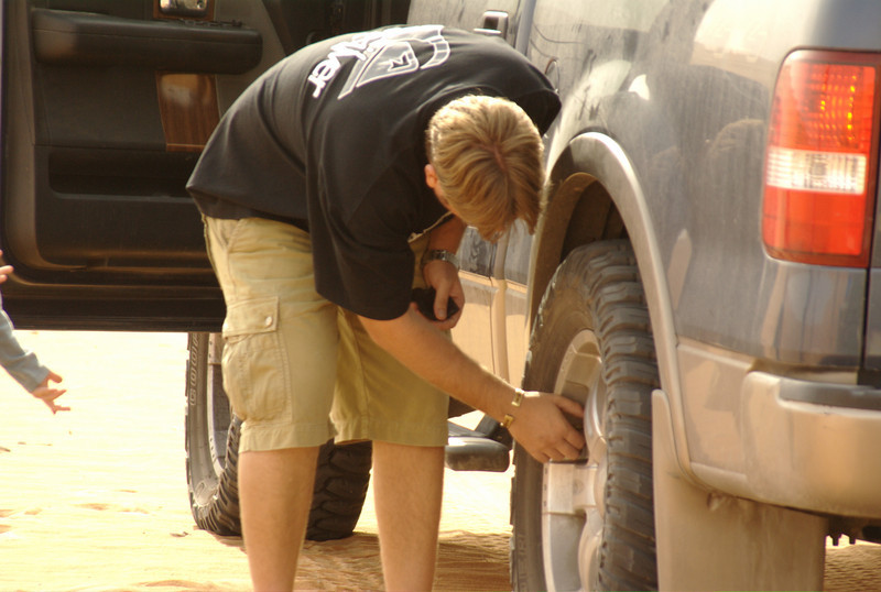 Shaun, deflating the tires of his 4x4 in order to proceed through the dunes.