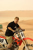 Shaun, returning from a quick spin around the massive dunes in the Liwa desert.