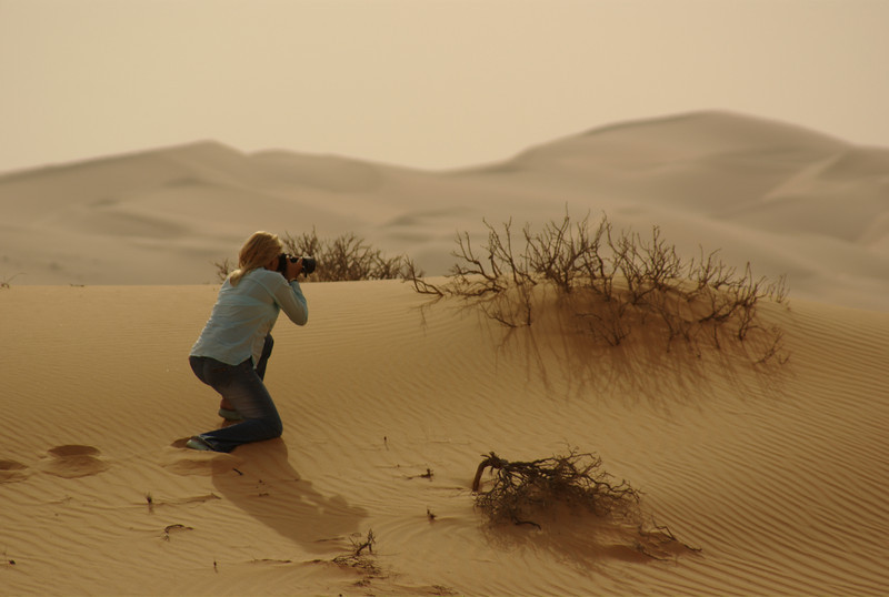 'Ant' taking a picture of the little bit of foliage in the deserts of Liwa.