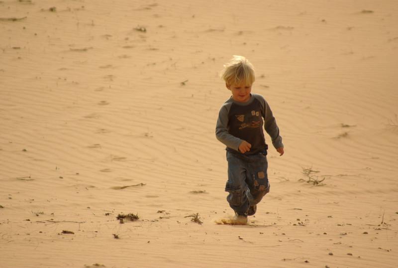 Jordan running to us in the desert.