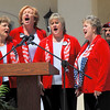 Members of the Pipe Dreams of Sweet Adelines sing the National Anthem