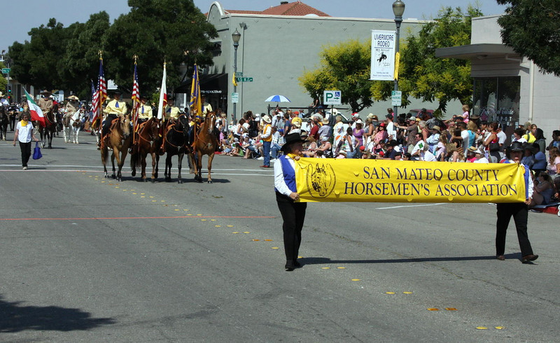The crowd looks on as the SMCHA Senior Color Guard rides in the Livermore Parade
