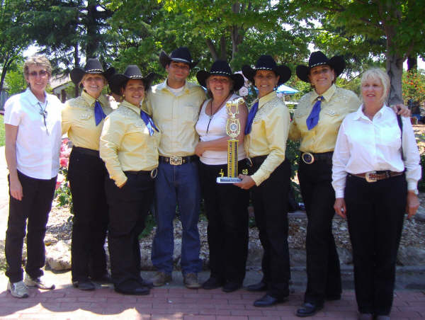 (L to R)- Susie Stewart (Ground Crew Captain), Krista Rodeen (Sr. Color Guard Rider), Gloria Acosta (Sr. Color Guard Rider), John Wilson (Ground Crew), Barbara Stogner (SMCHA Banner carrier), Anne Whitten (Captain Senior Color Guard & Rider), Judi Del Ponte (Sr. Color Guard Rider), and Adeline Forrest (SMCHA Bannier carrier)