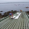 Sarah moving the White Boards on the boat ramp.