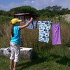 Doing laundry on the Island, hanging clothes to dry.