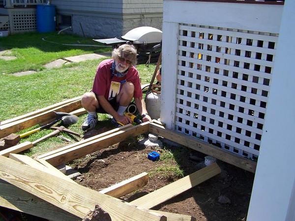 Keeper John working on BBQ grill deck.