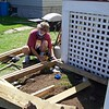 Keeper John working on BBQ grill deck.