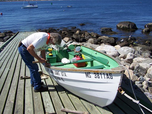 Keeper John replaces the side of skiff where lobster pot ropes  are pulled up with copper.
