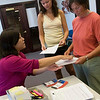 Record-Eagle/Douglas Tesner<br /> Traverse City Film Festival intern Eileen Tseng works with volunteers Karen Richardson and her daughter Bethany Richardson as they pick up their credentials at the 2008 Traverse City Film Festival office.