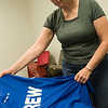 Record-Eagle/Douglas Tesner<br /> After picking up her credentials volunteer Joyce Peiffer picks out a crew T-shirt at the 2008 Traverse City Film Festival office.