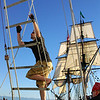 Climbing the lines on the Amazing Grace<br /> Lady Washington is in the background