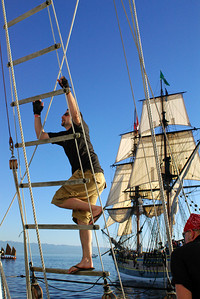 Climbing the lines on the Amazing Grace Lady Washington is in the background