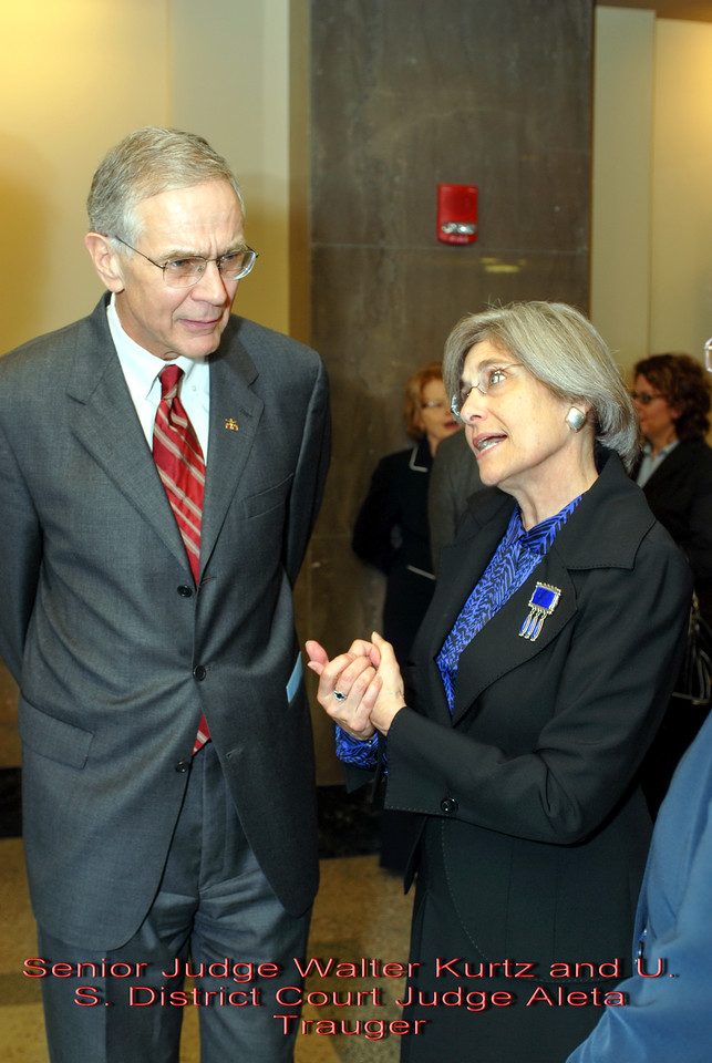 Metro Courthouse mezzanine reception on the occasion of the retirement of Davidson County Fifth Circuit Court Judge Walter Kurtz and his elevation to senior judge status---Senior Judge Walter Kurtz and U. S. District Court Judge Aleta Trauger.