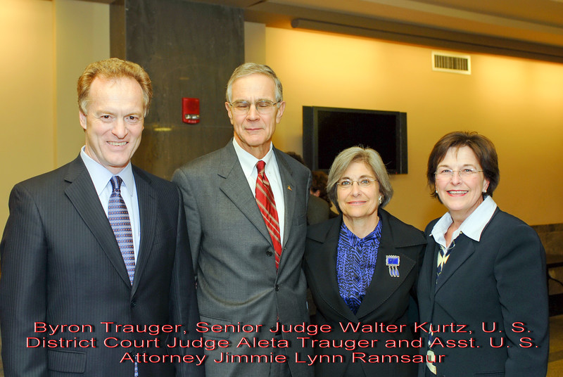 Metro Courthouse mezzanine reception on the occasion of the retirement of Davidson County Fifth Circuit Court Judge Walter Kurtz and his elevation to senior judge status---Byron Trauger, Senior Judge Walter Kurtz, U. S. District Court Judge Aleta Trauger and Asst. U. S. Attorney Jimmie Lynn Ramsaur.