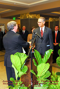 Metro Courthouse mezzanine reception on the occasion of the retirement of Davidson County Fifth Circuit Court Judge Walter Kurtz and his elevation to senior judge status---Justice Bill Koch of the Tennessee Supreme Court and Senior Judge Walter Kurtz.