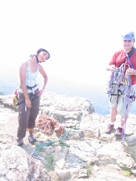 """At the top of  """"Chimney in the Chimney"""" route with my leader, Doug"""